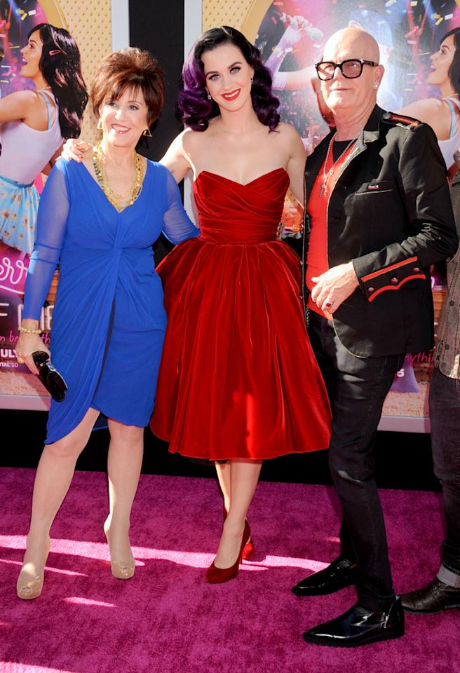 "HOLLYWOOD, CA - JUNE 26: Katy Perry (C) and mom Mary Perry Hudson and dad Keith Hudson arrive at ""Katy Perry: Part Of Me"" Los Angeles Premiere at Grauman's Chinese Theatre on June 26, 2012 in Hollywood, California.  (Photo by Gregg DeGuire/WireImage)"