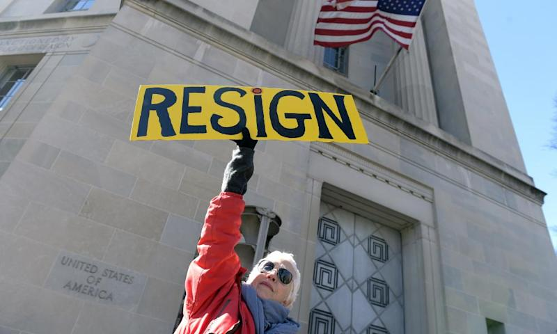 A protester outside the justice department in Washington on 2 March.