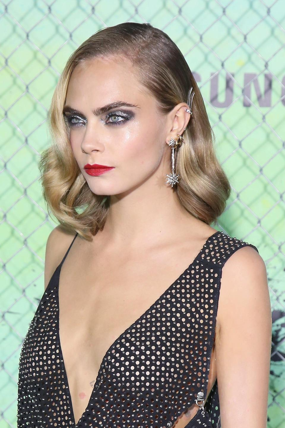 <p>It's not the first time Delevingne's worn Old Hollywood-style waves clipped off to one side with a jeweled accessory, but we're still not bored of it yet. </p>