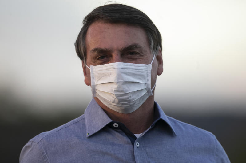 BRASILIA, BRAZIL - JULY 19: Jair Bolsonaro President of Brazil looks on in front of the official residence after testing positive for coronavirus (COVID-19) in Alvorada Palace on July 19, 2020 in Brasilia, Brazil. President Bolsonaro announced Tuesday July 07 he tested positive for COVID-19 after presenting symptoms. (Photo by Bruna Prado/Getty Images)