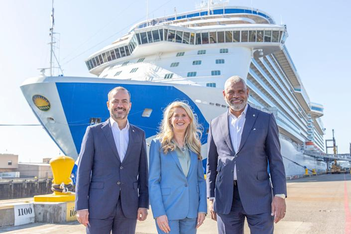 Gus Antorcha, President of Holland America Line (left), Jan Swartz, Princess Cruises President (middle) and Arnold Donald, President and CEO Carnival Corp. (right) in front of Majestic Princess in the Port of Seattle.