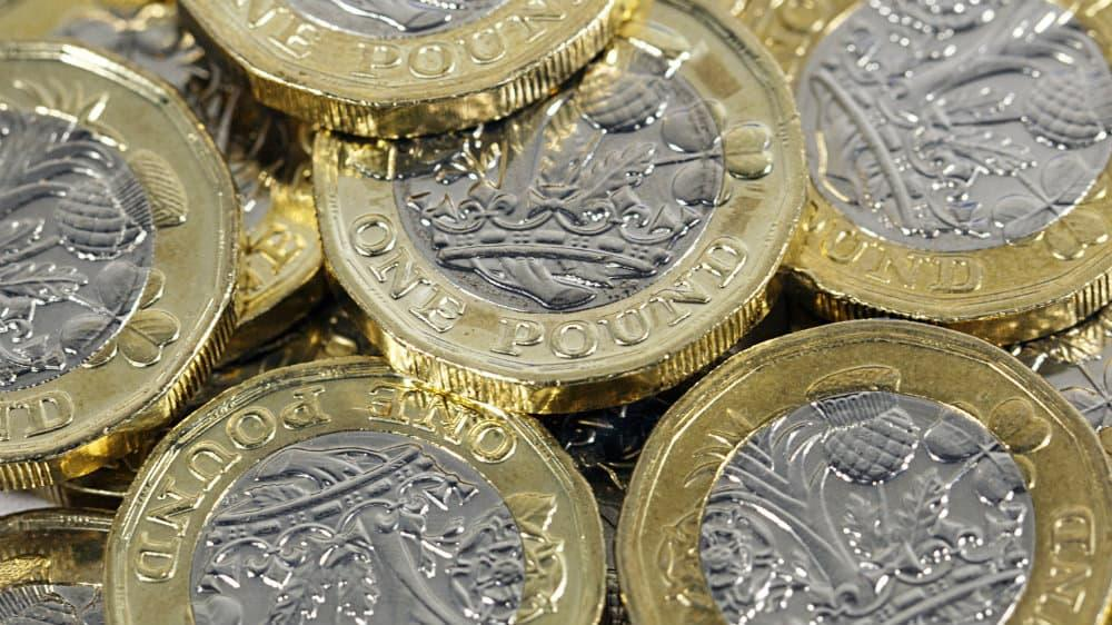 Stack of new one pound coins