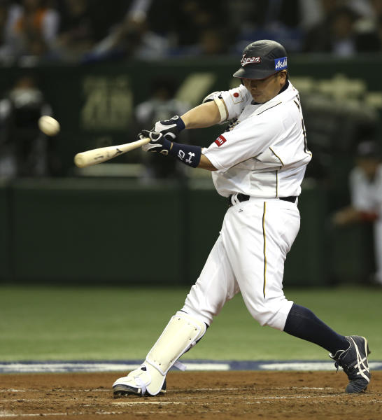 Japan's designated hitter Shinnosuke Abe hits a solo homer off Netherlands' starter David Bergman in the second inning of their World Baseball Classic second round game at Tokyo Dome in Tokyo, Tuesday, March 12, 2013. (AP Photo/Toru Takahashi)