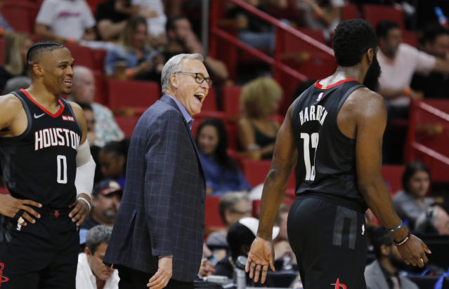 Rockets coach Mike D'Antoni, center, shares a laugh with James Harden (13) and Russell Westbrook (0) during a preseason game. (AP Photo/Joe Skipper)