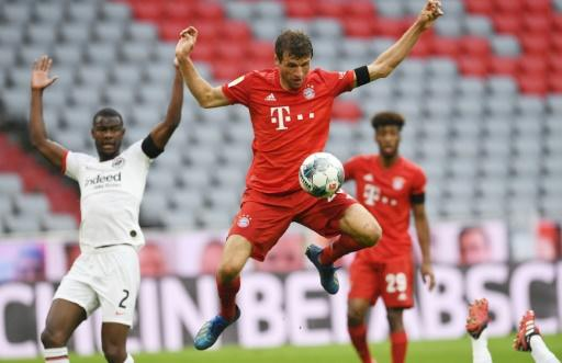 Bayern Munich forward Thomas Mueller controls the ball just before scoring in Saturday's 5-2 win at home to Eintracht Frankfurt