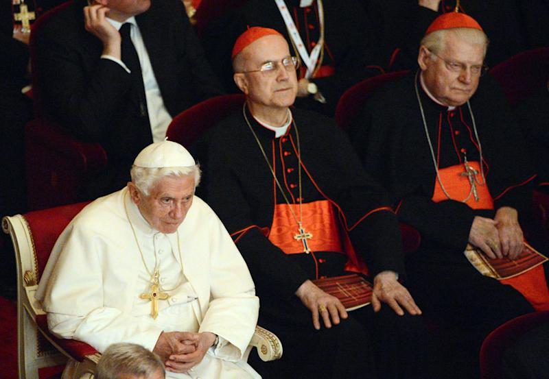 Pope Benedict XVI, the Vatican State Secretary Cardinal Tarcisio Bertone, center, and the bishop of Milan, Angelo Scola, right, attend a concert at La Scala theater in Milan, Italy, Friday, June 1, 2012. Pope Benedict XVI greeted the faithful in the square outside Milan's cathedral after his arrival Friday afternoon for the seventh World Encounter of Families, a welcome pastoral respite from an embarrassing and damaging leaks scandal at the Vatican that has engulfed the pontiff's personal butler. Then, a concert at the nearby La Scala theater will be followed by a private prayer inside the cathedral with a special focus on the victims of the twin temblors that rocked the Emilia-Romagna region last month. (AP Photo/Daniel Dal Zennaro, Pool)
