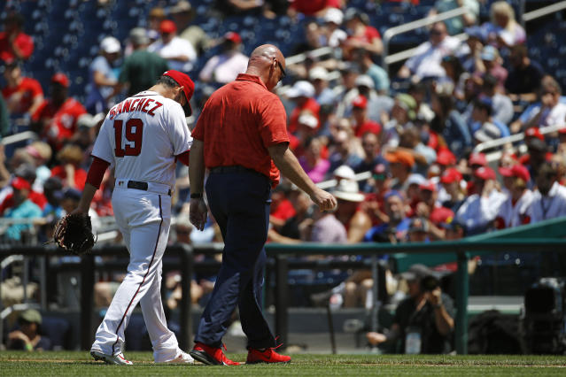 Washington Nationals starting pitcher Anibal Sanchez (19) walks off the field alongside head athletic trainer Paul Lessard after being relieved in the second inning of a baseball game against the New York Mets, Thursday, May 16, 2019, in Washington. (AP Photo/Patrick Semansky)
