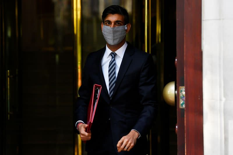 Britain's Chancellor of the Exchequer, Rishi Sunak, leaves a television studio in London