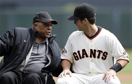 San Francisco Giants catcher Buster Posey, right, talks with former Giants player Willie Mays during a ceremony to award Posey the National League MVP award before a baseball game against the St. Louis Cardinals on Saturday, April 6, 2013 in San Francisco. (AP Photo/Marcio Jose Sanchez)