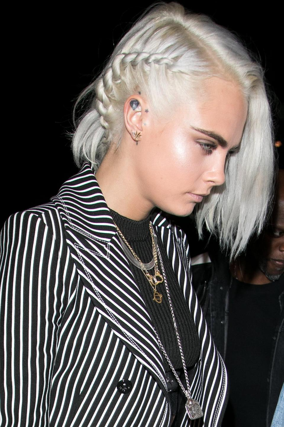 <p>Delevingne gave up for favorite side braid for a unexpected twist . . . literally, weaving a rope-like twist into one side of nearly white-blond bob. </p>