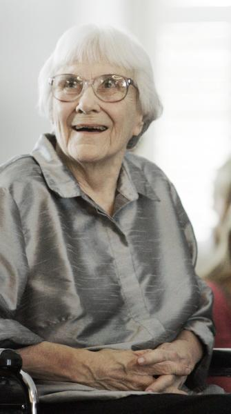 """FILE - In this Aug. 20, 2007, file photo, author Harper Lee smiles during a ceremony honoring the four new members of the Alabama Academy of Honor at the Capitol in Montgomery, Ala. """"To Kill a Mockingbird"""" will be made available as an e-book and digital audiobook in July 2014, filling one of the biggest gaps in the electronic library. Author Harper Lee said in a rare public statement Monday, April 28, 2014, issued through HarperCollins Publishers, that while she still favored """"dusty"""" books she had signed on for making """"Mockingbird"""" available to a """"new generation."""" (AP Photo/Rob Carr, File)"""