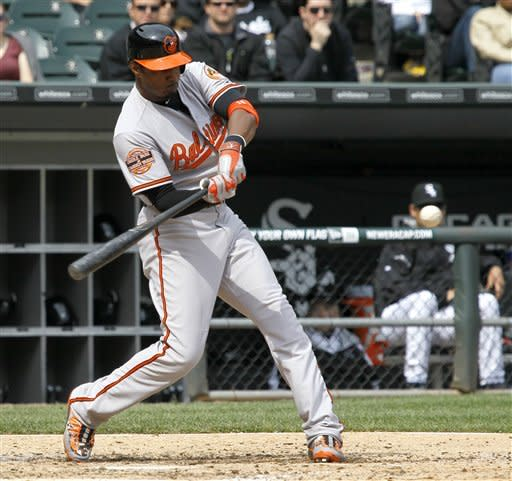 Baltimore Orioles' Adam Jones hits a two-run home run off Chicago White Sox starting pitcher Gavin Floyd during the fifth inning of a baseball game, Thursday, April 19, 2012, in Chicago. (AP Photo/Charles Rex Arbogast)