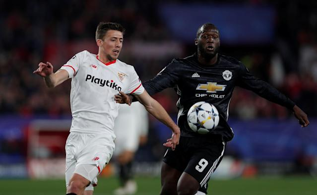 Soccer Football - Champions League Round of 16 First Leg - Sevilla vs Manchester United - Ramon Sanchez Pizjuan, Seville, Spain - February 21, 2018 Manchester United's Romelu Lukaku in action with Sevilla's Clement Lenglet Action Images via Reuters/Andrew Couldridge