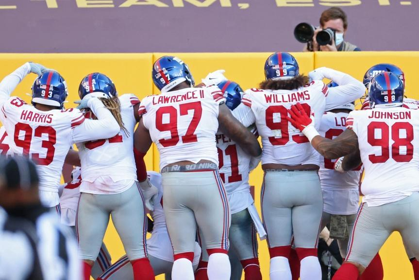 Nov 8, 2020; Landover, Maryland, USA; New York Giants strong safety Jabrill Peppers (21) celebrates with teammates after an interception. Against the Washington Football Team in the fourth quarter at FedExField.