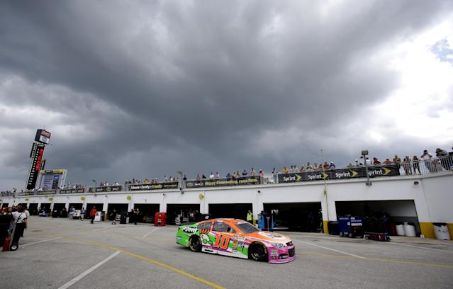 Danica Patrick (10) drives out to the track just before a weather delay stopped a NASCAR Sprint Cup practice session at Daytona International Speedway in Daytona Beach, Fla., Thursday, July 3, 2014. (AP Photo/John Raoux)