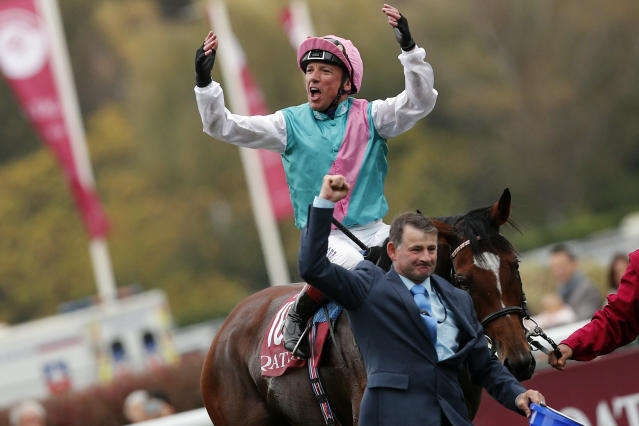 Italian Lanfranco Dettori riding British horse Enable, celebrates after winning the Qatar Prix de l'Arc de Triomphe horse race at the Longchamp horse racetrack, outskirts of Paris, France, Sunday, Oct. 7, 2018. (AP Photo/Francois Mori)