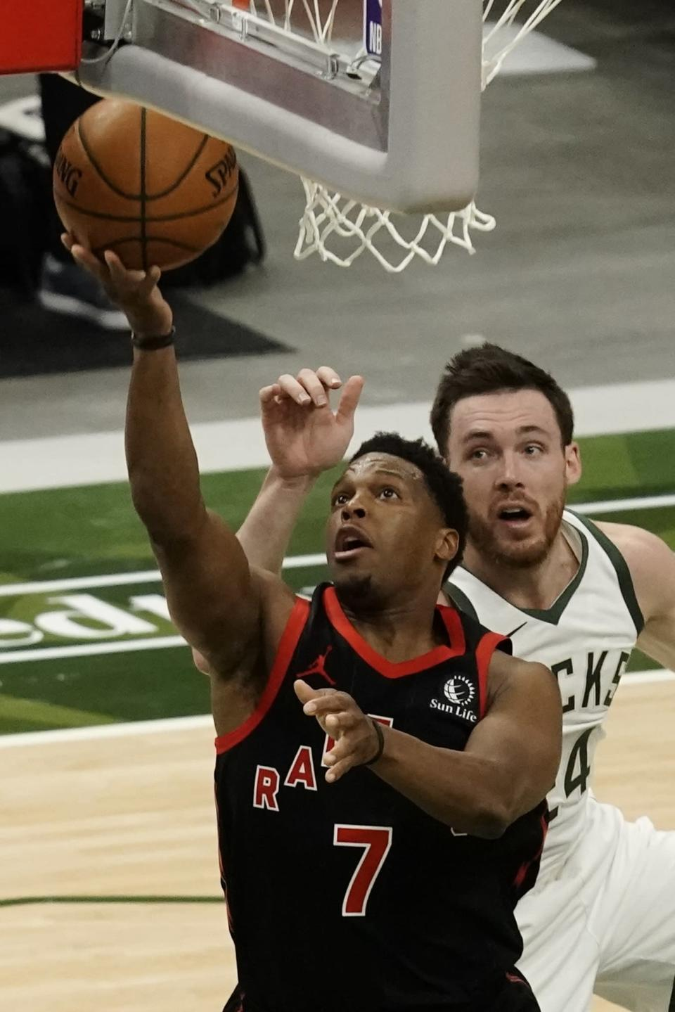 Toronto Raptors' Kyle Lowry shoots past Milwaukee Bucks' Pat Connaughton during the first half of an NBA basketball game Tuesday, Feb. 16, 2021, in Milwaukee. (AP Photo/Morry Gash)