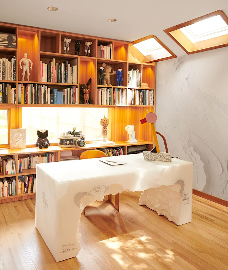 In the study, an Ettore Sottsass lamp sits atop a desk by Arsham.