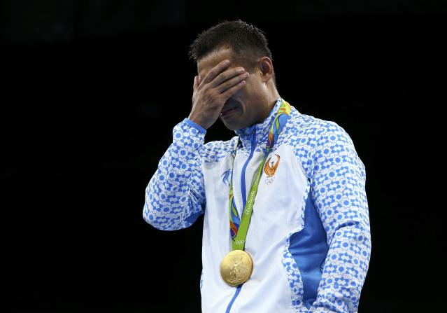 2016 Rio Olympics - Boxing - Victory Ceremony - Men's Light Welter (64kg) Victory Ceremony - Riocentro - Pavilion 6 - Rio de Janeiro, Brazil - 21/08/2016. Gold medallist Fazliddin Gaibnazarov (UZB) of Uzbekistan reacts. REUTERS/Peter Cziborra FOR EDITORIAL USE ONLY. NOT FOR SALE FOR MARKETING OR ADVERTISING CAMPAIGNS.