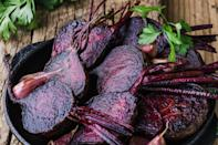 """<p>Vibrant red beets look beautiful and are easy to prepare, especially if you already have a hot oven ready to go. Simply clean and trim, season with salt and pepper, and roast for 60 to 90 minutes until tender. You can add these to a salad or grain bowl, but they also make a lovely side dish simply sliced.</p> <p><a href=""""https://www.thedailymeal.com/recipes/roasted-beets-recipe-0?referrer=yahoo&category=beauty_food&include_utm=1&utm_medium=referral&utm_source=yahoo&utm_campaign=feed"""" rel=""""nofollow noopener"""" target=""""_blank"""" data-ylk=""""slk:For the Roasted Beets recipe, click here."""" class=""""link rapid-noclick-resp"""">For the Roasted Beets recipe, click here.</a></p>"""