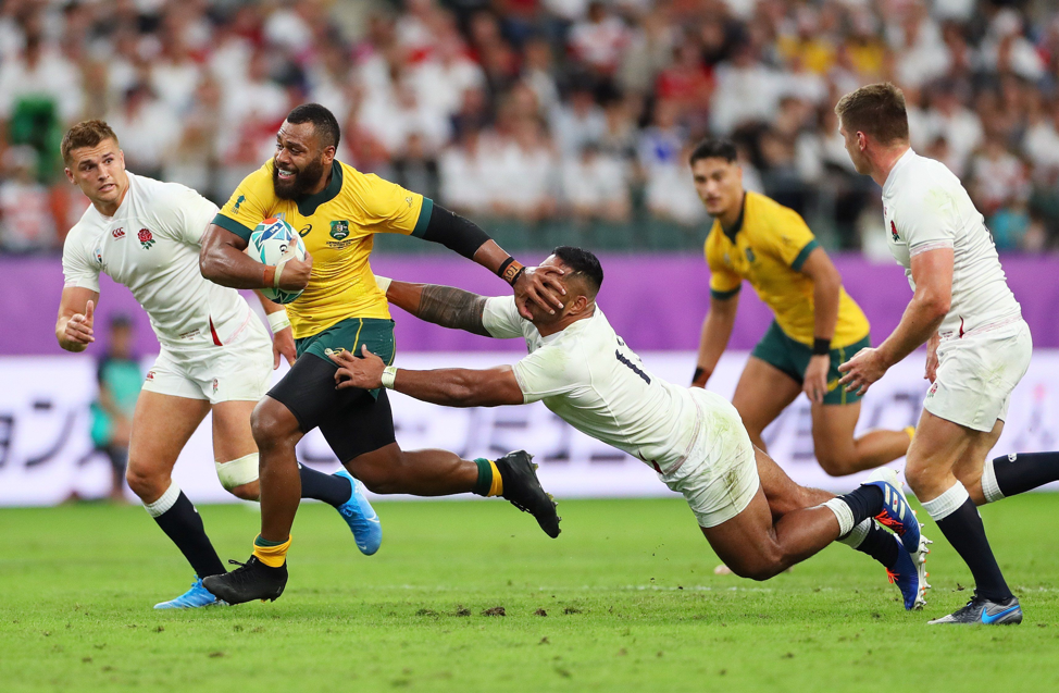 "England were worthy winners of this bruising quarter final encounter with Australia, and here Samu Kerevi of Australia hands off Manu Tuilagi of England. Photographer Dan Mullan (Getty Images) explains: ""By using a higher shutter speed I was able to capture the exact moment his hands were on his face."""