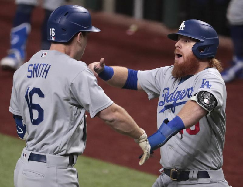 Will Smith, left, celebrates with Dodgers teammate Justin Turner after hitting a three-run home run.