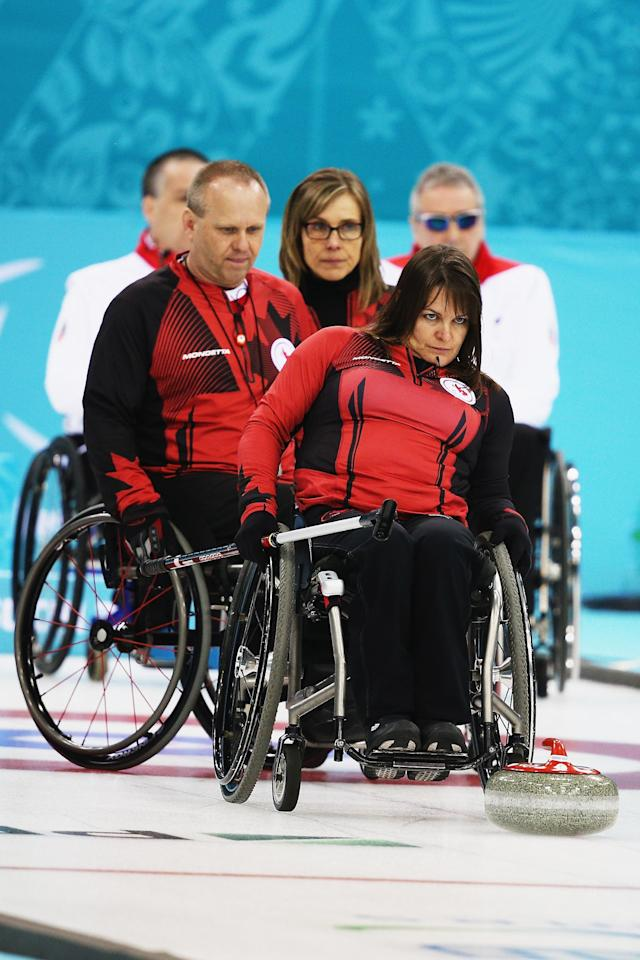 SOCHI, RUSSIA - MARCH 08: Ina Forrest of Canada competes in the wheelchair curling mixed round robin match between Canada and Great Britain at the Ice Cube Curling Center on March 8, 2014 in Sochi, Russia. (Photo by Hannah Peters/Getty Images)