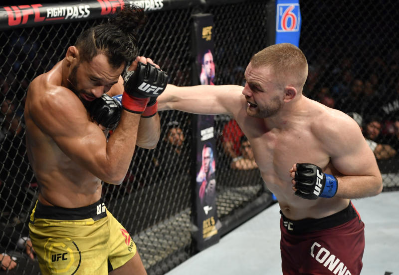 VANCOUVER, BRITISH COLUMBIA - SEPTEMBER 14: (R-L) Tristan Connelly of Canada punches Michel Pereira of Brazil in their middleweight bout during the UFC Fight Night event at Rogers Arena on September 14, 2019 in Vancouver, Canada. (Photo by Jeff Bottari/Zuffa LLC/Zuffa LLC)