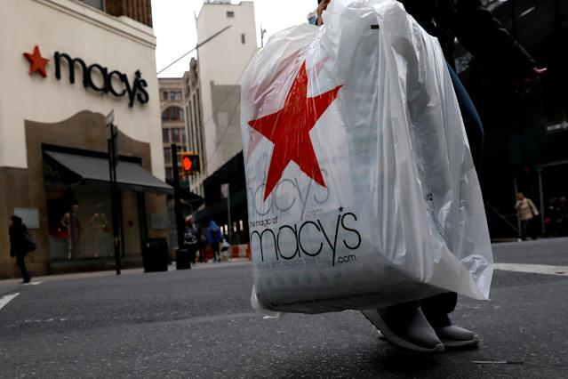 A customer exits after shopping at a Macy's store in the Brooklyn borough of New York, U.S., May 11, 2017. REUTERS/Brendan McDermid