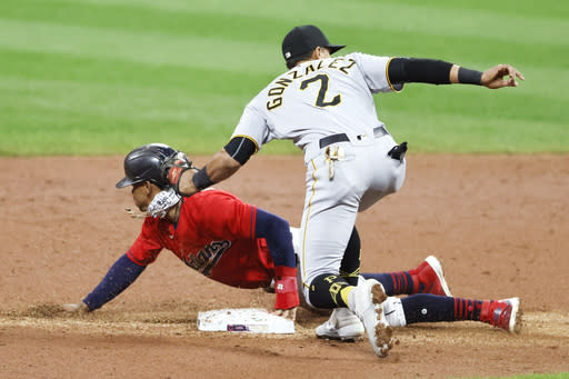 Cleveland Indians' Francisco Lindor, left, steals second base as Pittsburgh Pirates' Erik Gonzalez (2) covers during the third inning of a baseball game, Friday, Sept. 25, 2020, in Cleveland. (AP Photo/Ron Schwane)