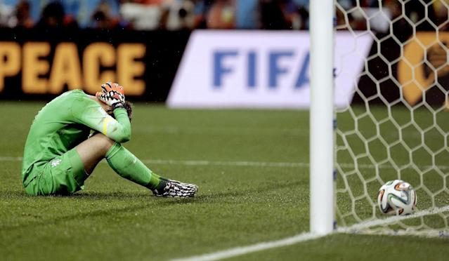 10ThingstoSeeSports - Netherlands' goalkeeper Jasper Cillessen reacts after being scored on by Argentina's Maxi Rodriguez during a penalty shootout after extra time during the World Cup semifinal soccer match between the Netherlands and Argentina at the Itaquerao Stadium in Sao Paulo Brazil, Wednesday, July 9, 2014. Argentina defeated the Netherlands 4-2 in a penalty shootout after a 0-0 tie to advance to the finals. (AP Photo/Natacha Pisarenko, File)