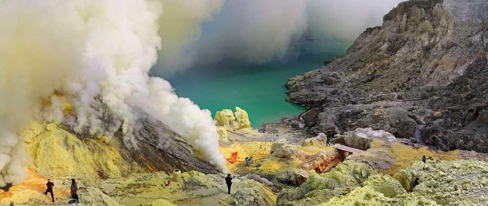 Indonesian sulphur miners spend 12 hours a day surrounded by acid-filled lakes and toxic smoke. They are paid just £3 and wear very little safety equipment (CATERS)