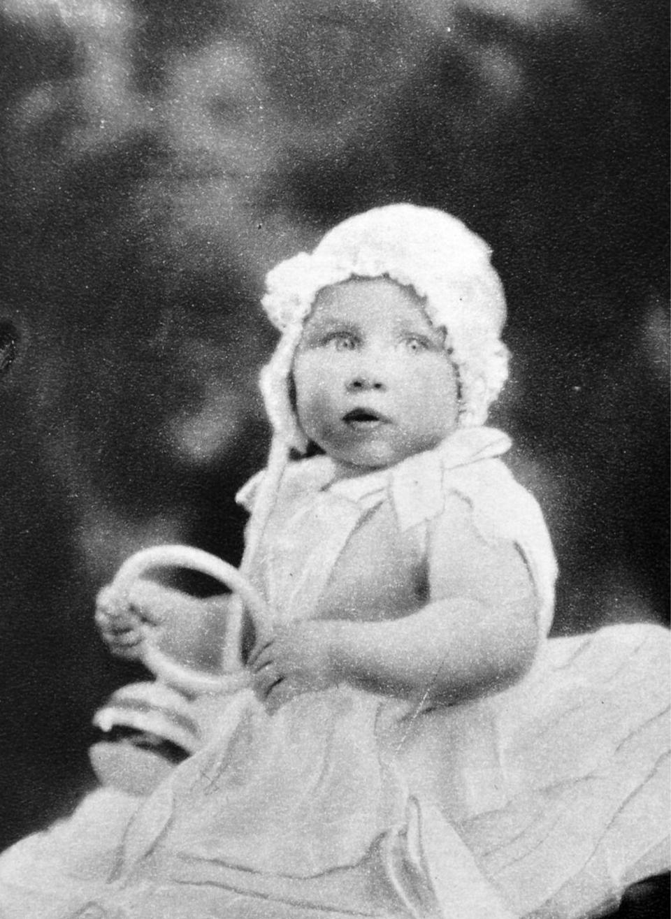 """<p>Princess Margaret, 5 months, plays with a rattle while posing for a photo in 1930. In 2013, <a href=""""http://royalcentral.co.uk/blogs/interview/princess-margarets-biographer-christopher-warwick-speaks-to-royal-central-16583"""" rel=""""nofollow noopener"""" target=""""_blank"""" data-ylk=""""slk:Margaret's biographer Christopher Warwick revealed"""" class=""""link rapid-noclick-resp"""">Margaret's biographer Christopher Warwick revealed</a> that the princess most enjoyed the drawing room at the palace. """"On the ground floor, there were 4 reception rooms–the Drawing Room, Dining Room, Library and Garden Room–all of which overlooked a spacious and well-stocked walled garden. But as the main living area in the house, the Drawing Room was where the Princess spent much of her time.""""</p>"""