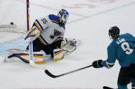 San Jose Sharks left wing Evander Kane (9) scores past St. Louis Blues goaltender Ville Husso (35) during overtime of an NHL hockey game in San Jose, Calif., Monday, March 8, 2021. (AP Photo/Jeff Chiu)