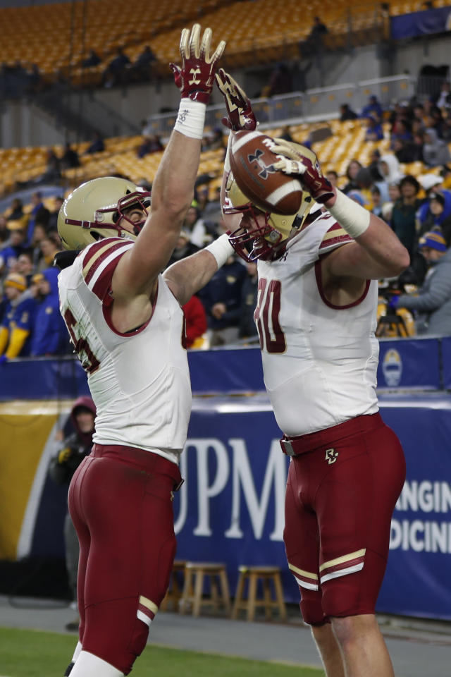 Boston College tight end Hunter Long (80) celebrates with tight end Korab Idrizi (85) after making a touchdown catch against Pittsburgh during the first half of an NCAA college football game, Saturday, Nov. 30, 2019, in Pittsburgh. (AP Photo/Keith Srakocic)