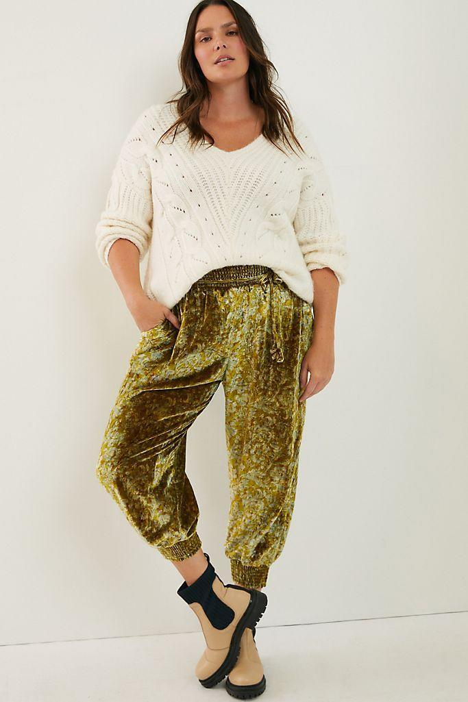 """<p><strong>Anthropologie</strong></p><p>anthropologie.com</p><p><strong>$79.95</strong></p><p><a href=""""https://go.redirectingat.com?id=74968X1596630&url=https%3A%2F%2Fwww.anthropologie.com%2Fshop%2Fgloria-velvet-joggers&sref=https%3A%2F%2Fwww.goodhousekeeping.com%2Fbeauty%2Ffashion%2Fg25400387%2Fnew-years-eve-outfits%2F"""" rel=""""nofollow noopener"""" target=""""_blank"""" data-ylk=""""slk:Shop Now"""" class=""""link rapid-noclick-resp"""">Shop Now</a></p><p>Joggers are perfect for NYE, especially when they come in velvet. Feel free to dress them up with heels or keep them casual with sneakers. </p>"""
