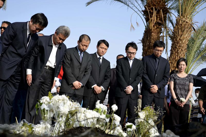 Dignitaries pay their respects to tourists from Hong Kong killed in a hot air balloon accident at the site during a memorial ceremony for the victims in Luxor, Egypt, Saturday, March 2, 2013. Nineteen people were killed on Tuesday, Feb. 26, 2013 in what appeared to be the deadliest hot air ballooning accident on record. The balloon was carrying 20 tourists from France, Britain, Belgium, Japan, Hong Kong, and an Egyptian pilot.(AP Photo/Ibrahim Zayed)
