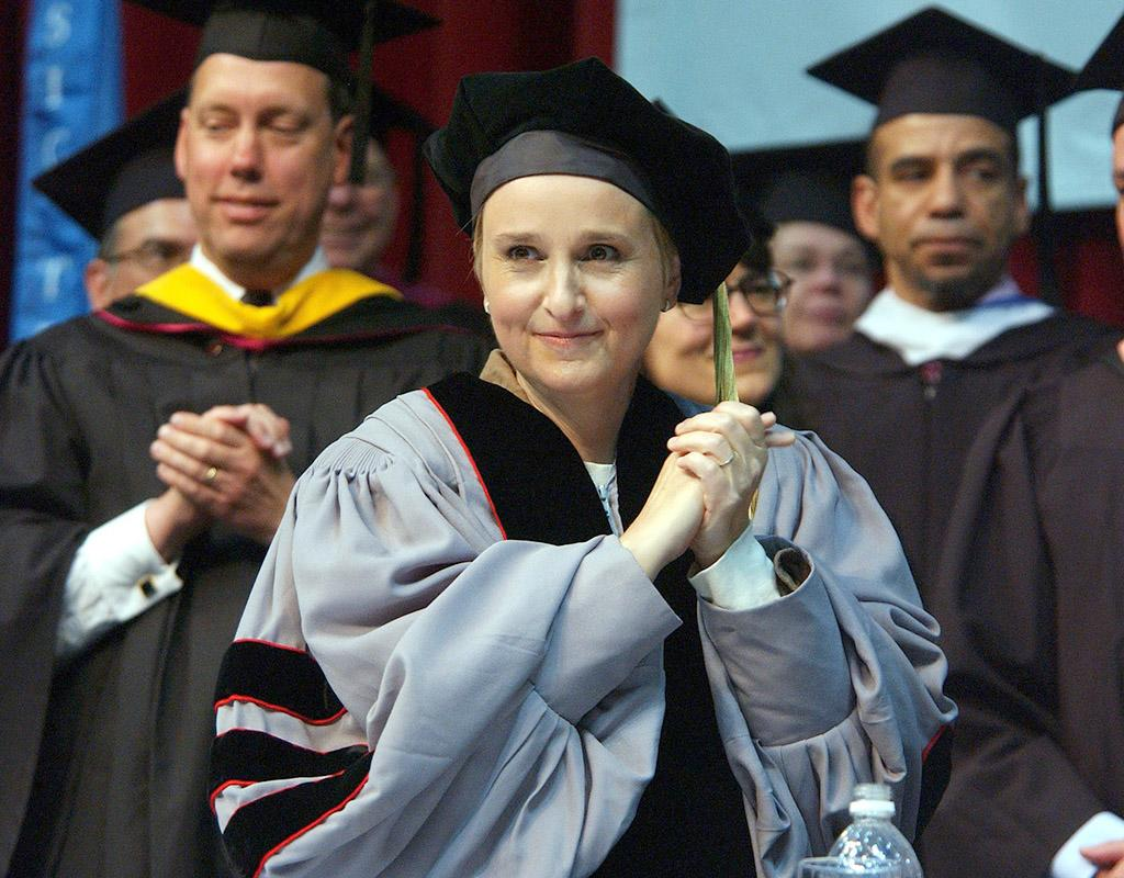 """<p class=""""MsoNormal""""><span style=""""mso-fareast-font-family: 'Times New Roman'; mso-bidi-font-family: 'Times New Roman';"""">Singer-songwriter Melissa Etheridge clasped her hands with joy before she gave the commencement address at the Berklee College of Music in 2006. The same day, she and Aretha Franklin both received honorary degrees for their achievements in music from the university. (5/13/2006)</span></p>"""