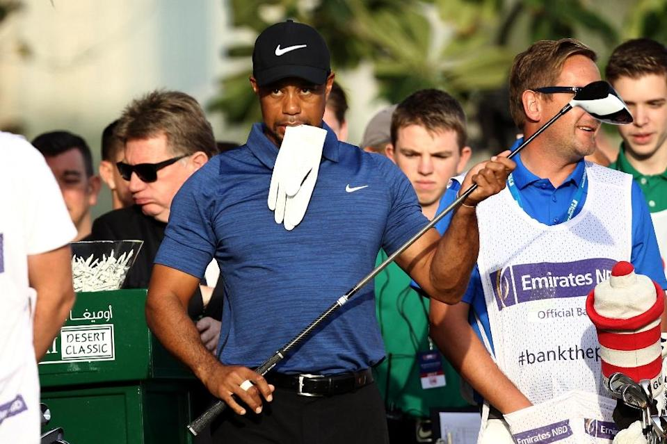Tiger Woods of the United States reacts after playing a shot during the Dubai Desert Classic golf tournament at the Emirates Golf Club in Dubai on February 2, 2017. (AFP Photo/NEZAR BALOUT)