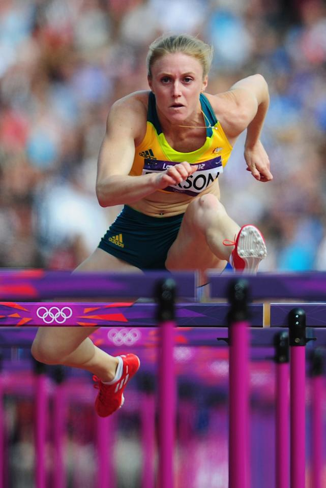 LONDON, ENGLAND - AUGUST 06:  Sally Pearson of Australia competes in the Women's 100m Hurdles heat on Day 10 of the London 2012 Olympic Games at the Olympic Stadium on August 6, 2012 in London, England. (Photo by Stu Forster/Getty Images)