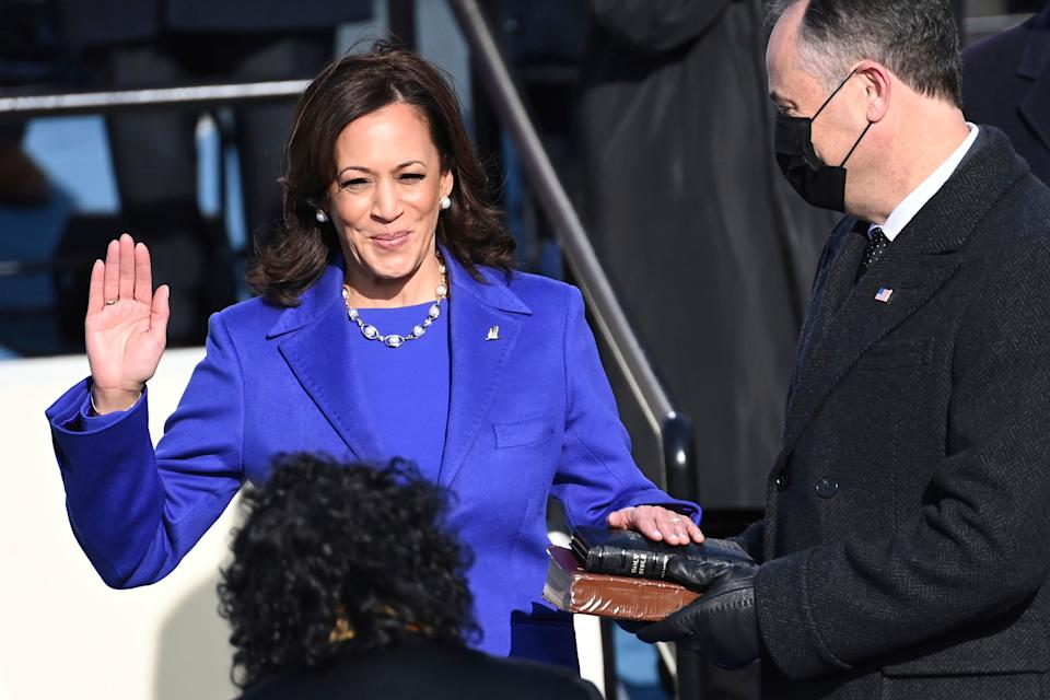 Kamala Harris — flanked by her husband, Doug Emhoff, who is holding two Bibles — is sworn in as vice president by Justice Sonia Sotomayor. (Photo: ASSOCIATED PRESS)
