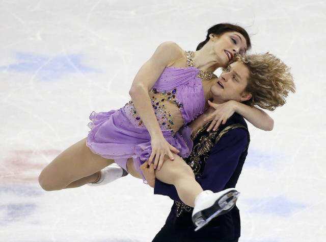 Meryl Davis and Charlie White compete during the ice dance free skate at the U.S. Figure Skating Championships in Boston, Saturday, Jan. 11, 2014. (AP Photo/Elise Amendola)