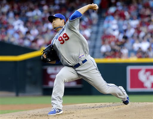 Los Angeles Dodgers pitcher Hyun-jin Ryu, of South Korea, delivers a pitch against the Arizona Diamondbacks during the first inning of a baseball game on Saturday, April 13, 2013, in Phoenix. (AP Photo/Matt York)