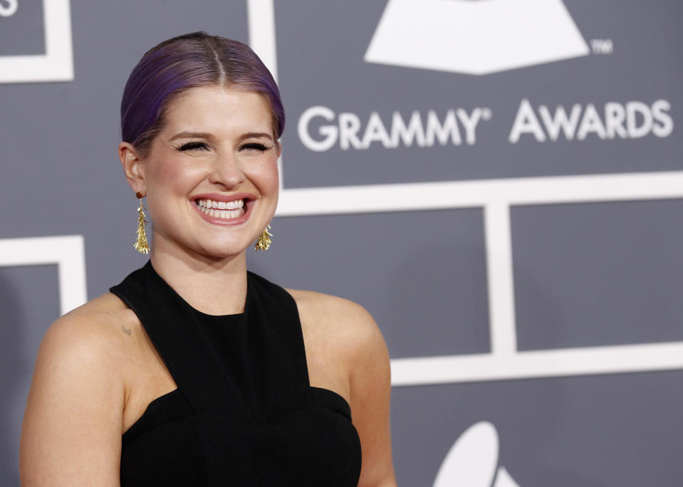 Television personality Kelly Osbourne arrives at the 55th annual Grammy Awards in Los Angeles, California February 10, 2013. REUTERS/Mario Anzuoni (UNITED STATES - Tags: ENTERTAINMENT) (GRAMMYS-ARRIVALS)