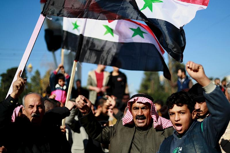 Syrian demonstrators in the northeastern Syrian Kurdish-majority city of Qamishli asking for the Syrian army's protection as Turkey threatens to carry out a fresh offensive following the US move to withdraw (AFP Photo/Delil SOULEIMAN)