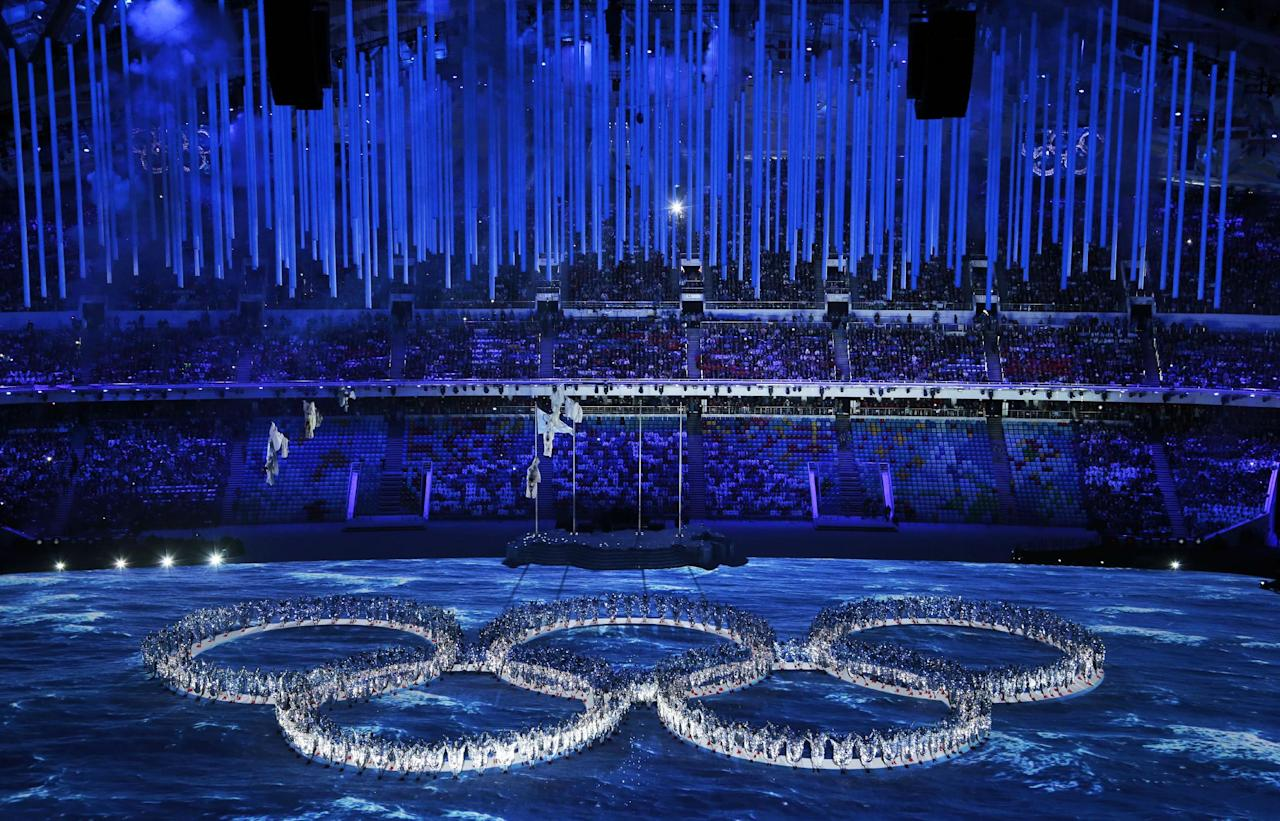 Performers create the Olympic rings during the closing ceremony of the 2014 Winter Olympics, Sunday, Feb. 23, 2014, in Sochi, Russia (AP Photo/Ivan Sekretarev)