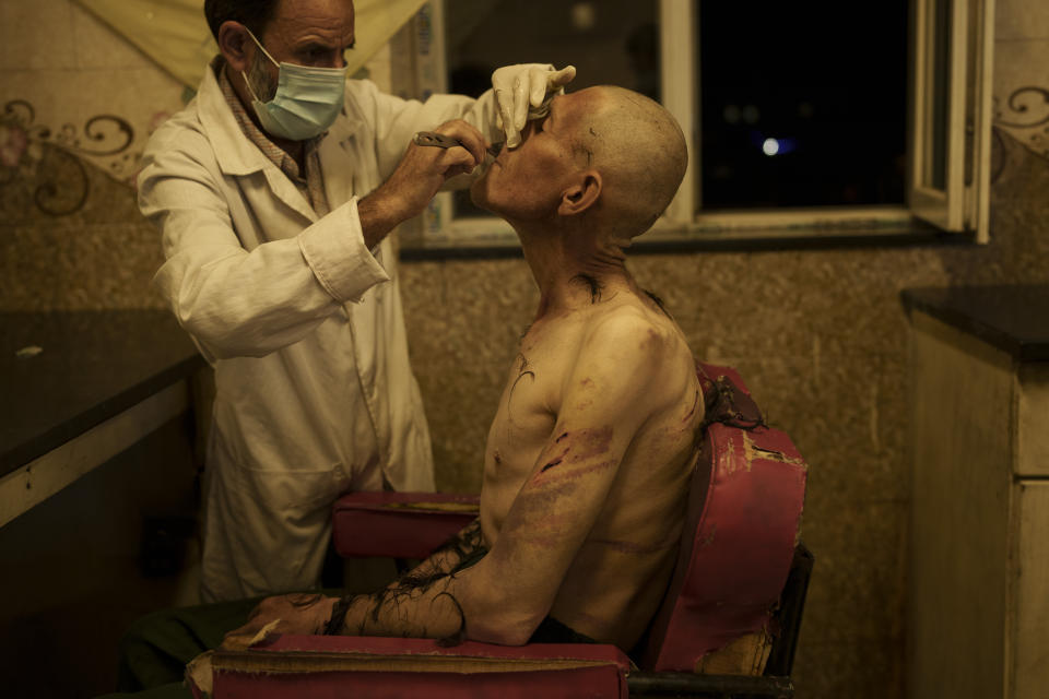 A drug user detained during a Taliban raid is shaved after arriving at Avicenna Medical Hospital for Drug Treatment in Kabul, Afghanistan, Saturday, Oct. 2, 2021.