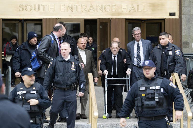 Harvey Weinstein, third from right, is surrounded by court officers as he leaves court following a pre trial hearing, Monday, Jan. 6, 2020, in New York. The disgraced movie mogul faces allegations of rape and sexual assault. (AP Photo/Mary Altaffer)