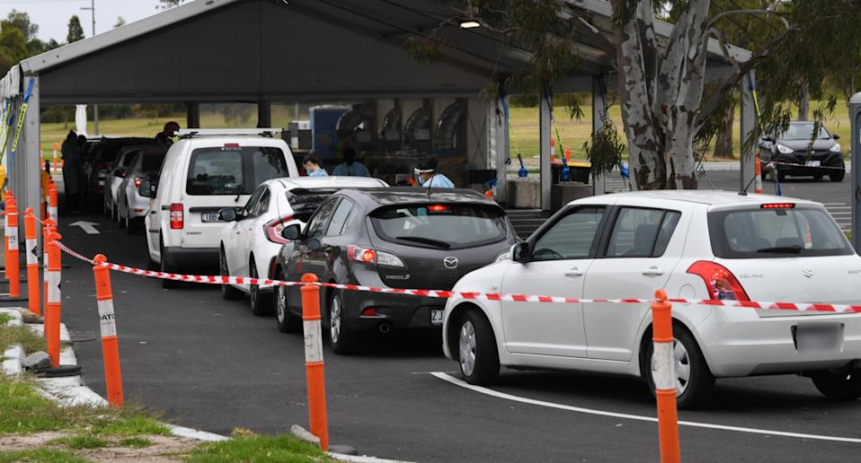 Cars line up at a coronavirus testing site in Victoria.