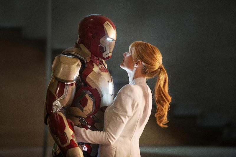 "This film publicity image released by Disney-Marvel Studios shows Robert Downey Jr. as Tony Stark/Iron Man and Gwyneth Paltrow as Pepper Potts with in a scene from ""Iron Man 3."" Hollywood is expected to have a banner year as box office totals are projected to peak at just under $11 billion, bringing in more multiplex revenue in 2013 than ever before. (AP Photo/Disney, Marvel Studios)"